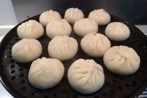 Steamed baozi filled with pork and vegetable
